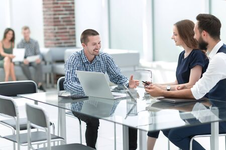 business team discussing new ideas sitting at the office Desk