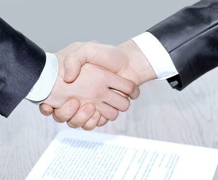 close up. handshake business partners after signing the contract.
