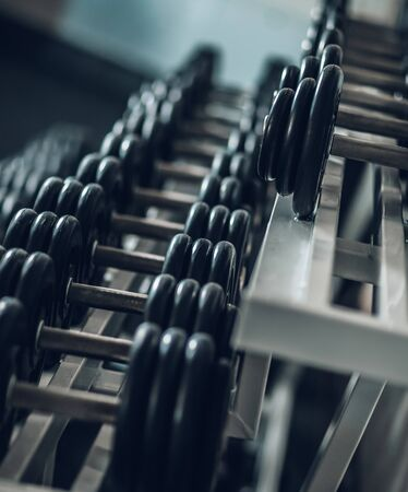 close up. Rows of dumbbells in the gym .