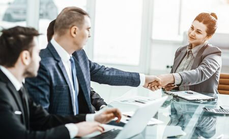 concept of partnership:a handshake of a Manager and a customer a Stock Photo