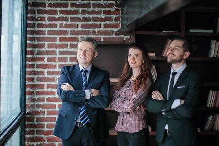 group of business partners standing in office. Stok Fotoğraf