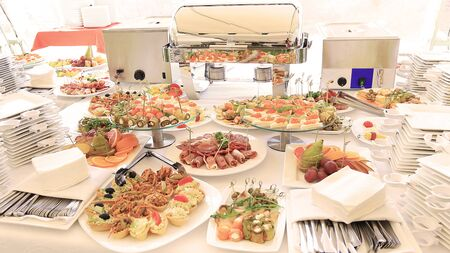 catering table set service with silverware and glass Archivio Fotografico