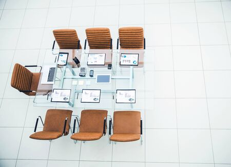 chairs and Desk with documents and laptop for negotiations with business partners Banque d'images