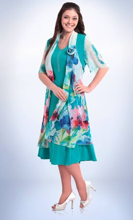 in full growth. smiling female model in bright summer suit.