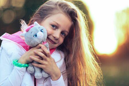 Pretty little girl hugging a favorite stuffed animal Stock Photo