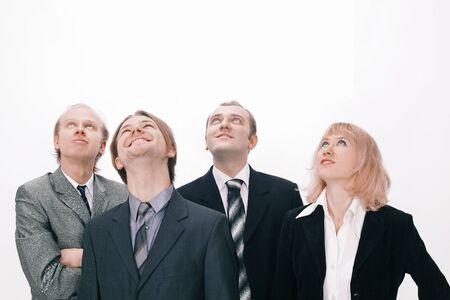A group of business people looking at copy space Stock Photo