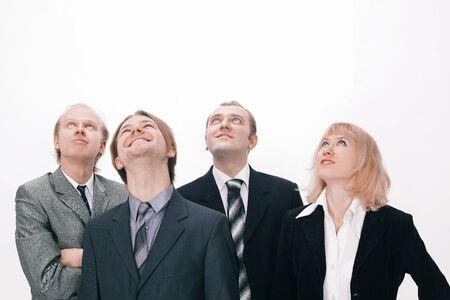 Eine Gruppe von Geschäftsleuten, die Kopienraum betrachten Standard-Bild