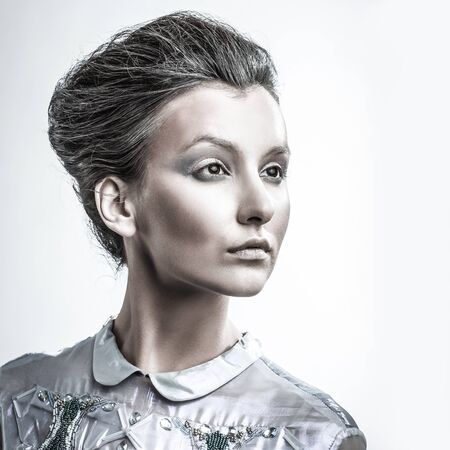 portrait of fashionable woman with stylish hair and evening makeup