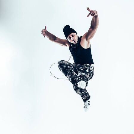 young rapper dancing break dance .photo on a white background.