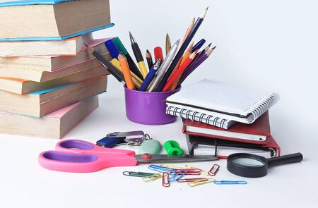 open the diary and colourful school supplies on a white background