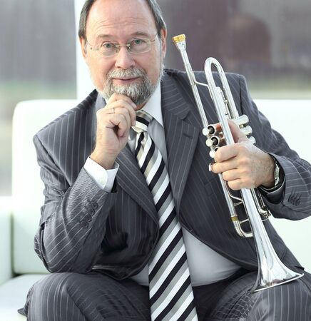 portrait of adult male musician with a trumpet. Stock Photo
