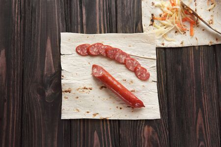 smoked salami with pita bread on wooden background Stock fotó