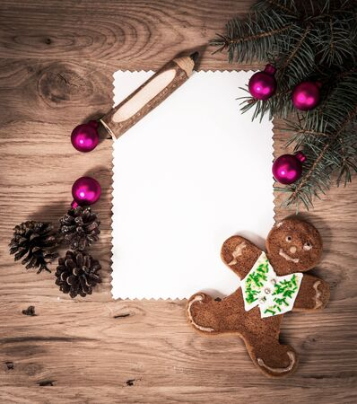 blank sheet of paper in the wooden floor with a pencil and Christmas decorations Reklamní fotografie