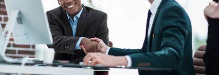 handshake international business partners on a Desk 写真素材