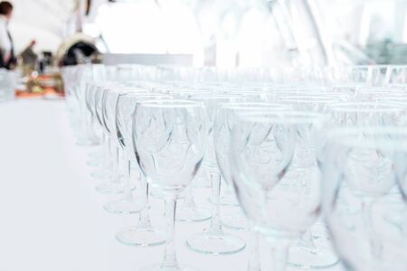 Lots of empty glass glasses on the table in the restaurant Stok Fotoğraf