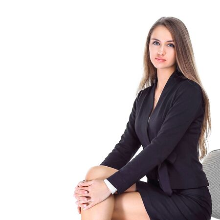 Confident business woman sitting on office chair Stok Fotoğraf