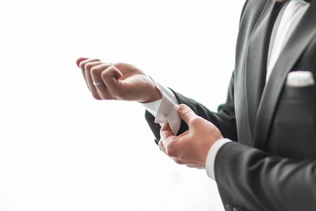 close up. a serious man adjusting his cuff links. Stock Photo