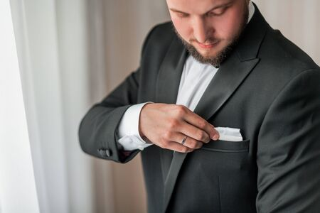 close up. serious man buttoning his jacket. Stock Photo