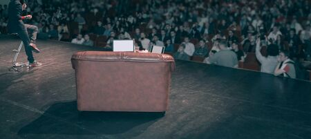 Rear view of speaker giving a talk on corporate Business Conference.