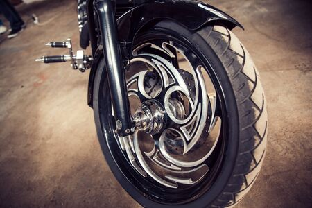 close up. the front wheel is a cool custom motorcycle
