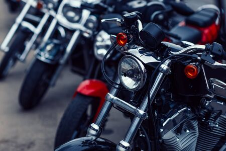 rows of motorcycles in the motorcycle salon. Фото со стока - 129921292
