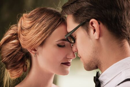 portrait of bride and groom looking at each other