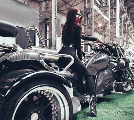 stylish woman model at the exhibition in the prestigious motor show Banco de Imagens