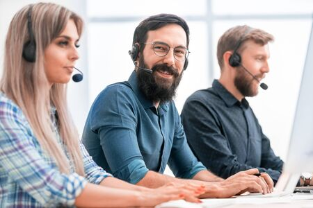 employees of the business center sitting at his Desk Stock Photo