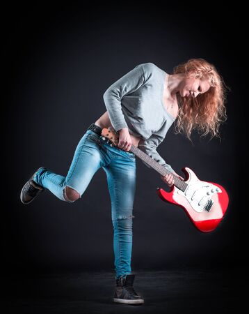 crazy young woman with a guitar playing jazz composition Stock Photo