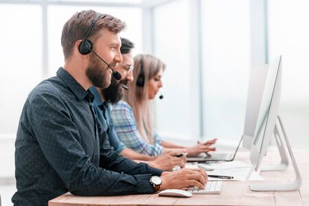 call center employees work on modern computers