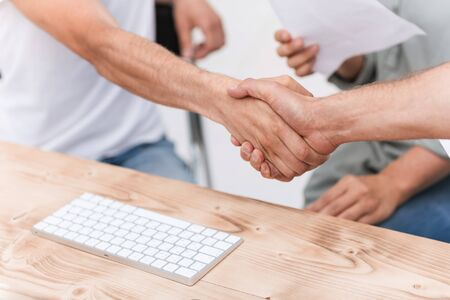 close up. background image of friendly handshake of employees . Stock fotó - 129921320
