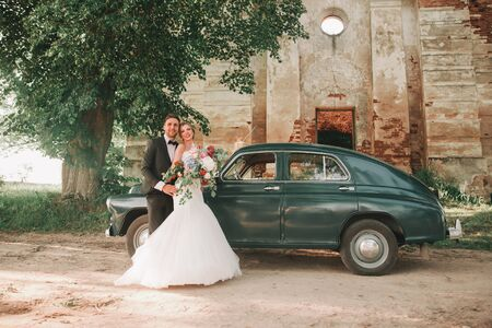 happy newlyweds on a walk near the old castle .