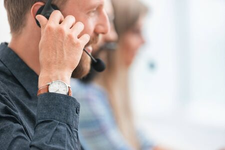 close up. smiling call center employee looking at you Stock Photo