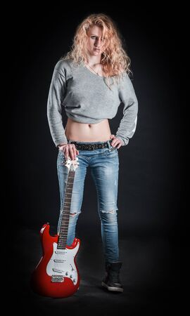 rock singer with guitar standing on stage