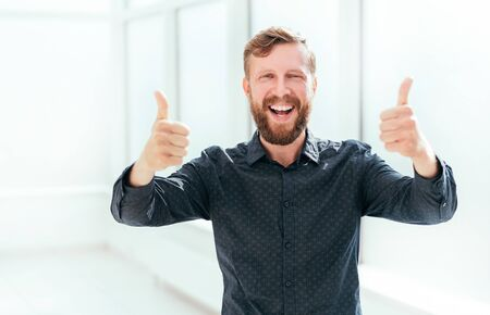 happy businessman showing thumbs up. photo with copy space Reklamní fotografie