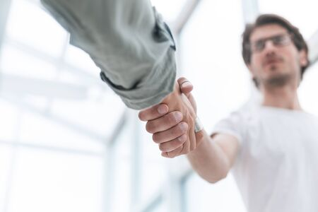 close up.young man shaking hands with his business partner