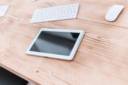 close up. digital tablet on the office Desk.