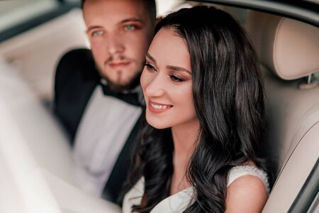 close up. a happy couple of newlyweds sitting in the car. Stock Photo