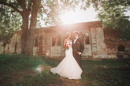 couple of newlyweds on a walk near an abandoned estate Stock Photo
