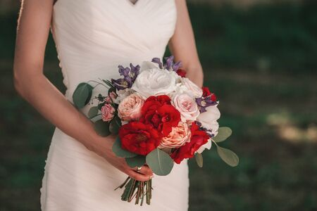 close up.wedding bouquet in the hands of the bride.