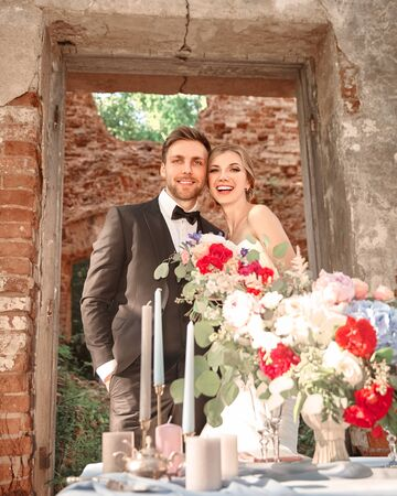 beautiful newlyweds on the background of an ancient castle.