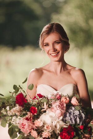 close up. happy bride with a bouquet of flowers