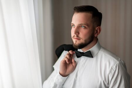 portrait of a handsome man with a bow tie Stock Photo