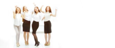 full-length portrait of the triumphant business team. blurred image for the advertising text. photo with copy space