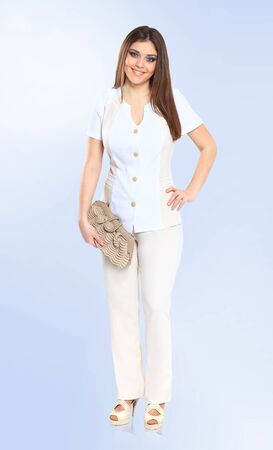 in full growth. attractive female model in a chic white suit 版權商用圖片