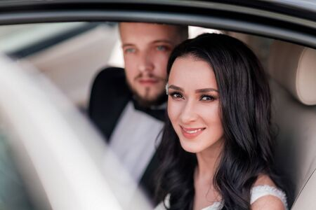 close up. a happy couple of newlyweds sitting in the car. Reklamní fotografie