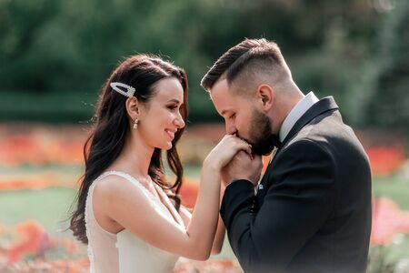 happy groom kissing his bride. holidays and events