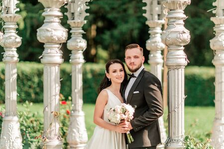 close up. bride and groom standing in an arched gazebo
