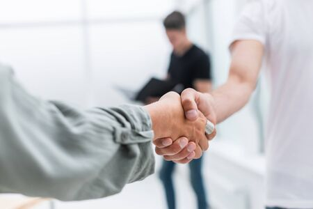 close up. background image of a business handshake