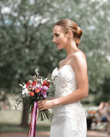 side view. happy bride with a wedding bouquet. Stock Photo